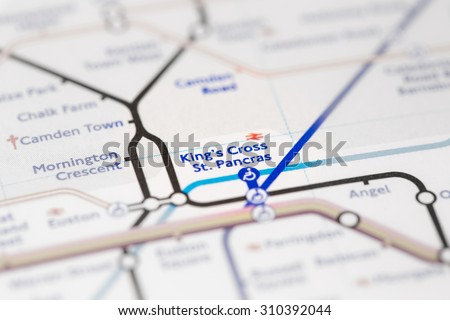 View of King's Cross St. Pancras station on a London subway map. (selective colouring) - stock photo