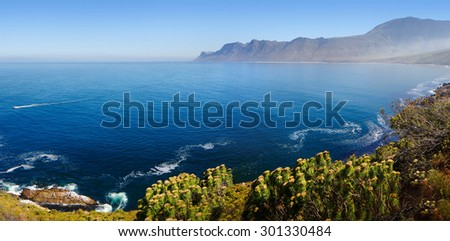 View of Kogelberg Nature Reserve area (viewed towards Cape Point over ocean from Clarence Drive) - Western Cape Province - South Africa - stock photo