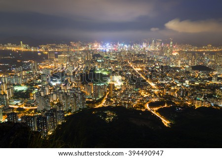 View of Kowloon in Hong Kong from above from the Lion Rock in Hong Kong, China, at night.