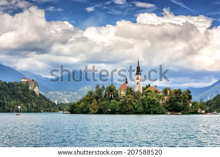 View of Lake Bled located in Slovenia Europe. There is St. Marya�´s Church of the Assumption on the Island and ancient castle on top of a rock. - stock photo