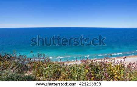 View of Lake Michigan from atop the dunes at overlook #9 on the Pierce Stocking Scenic Drive at Sleeping Bear Dunes National Lakeshore - stock photo