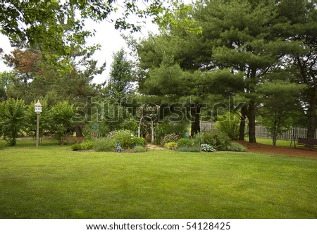 View of landscaped backyard of home - stock photo
