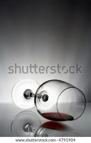 view of laying fragile wine glass on gray background