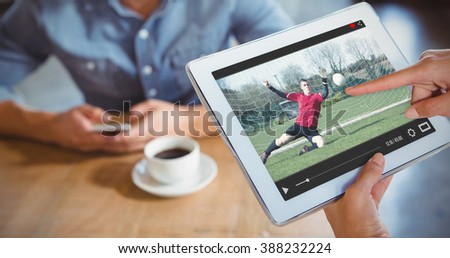 View of lecture app against person using tablet computer in cafe - stock photo