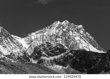 View of Lhotse (8516 m) from the Ngozumba Tsho ( the fifth Gokyo lake ) - Nepal, Himalayas (black and white) - stock photo