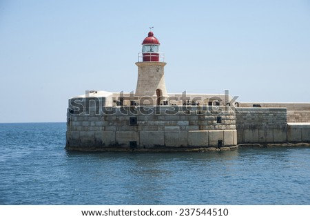 View of lighthouse in Grand Harbour, Valletta, Malta, Mediterranean, Europe