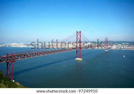 View of Lisbon and 25 de Abril bridge over Tagus river - stock photo