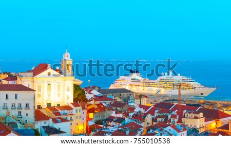View of Lisbon Old Town and sea port with luxury cruise ship. Portugal