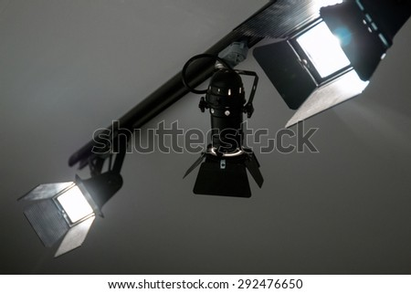 View of lit studio headlights on the ceiling.