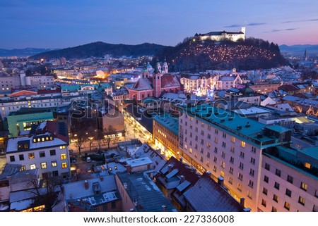 View of Ljubljana streets with traffic and skyline from Neboticnik just after the sunset, Slovenia - stock photo