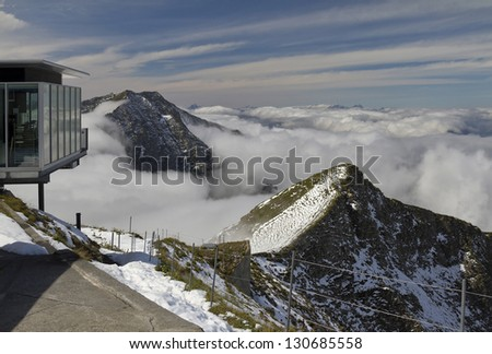 View of lonely mountain peak from the Niesen Kulm - stock photo