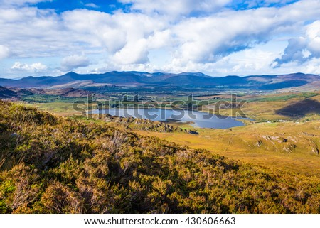 View of Lough Acoose in Ballycullane from the foothill of Macgillycuddy's Reeks mountain range in Kerry Ireland
