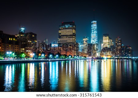 View of Lower Manhattan from Pier 34 at night, in Hudson River Park, Manhattan, New York.