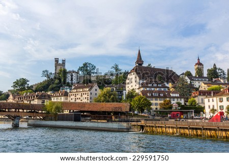 View of Lucerne old town from lake Lucerne in a foggy morning. - stock photo