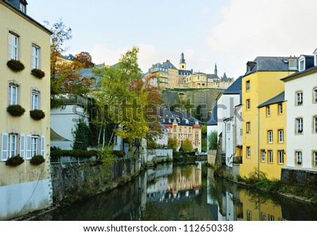 View of Luxembourg city from the river in a calm autumn evening - stock photo