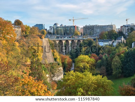 View of Luxembourg city in a calm autumn evening with old and modern districts - stock photo