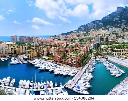 View of luxury yachts and apartments in harbor of Monaco, Cote d'Azur.Panorama. - stock photo