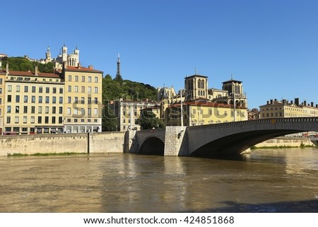 View of Lyon city and bridge over calm river in Lyon, France  - stock photo