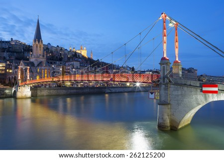 View of Lyon with Saone river and footbridge at night, France. - stock photo