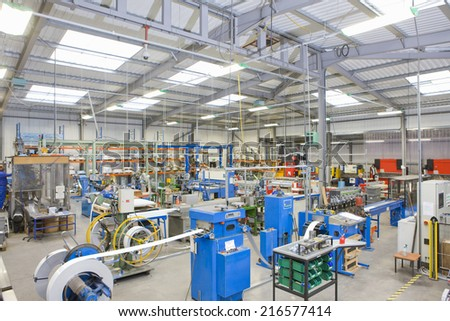 View of machinery in factory which manufactures aluminium light fittings