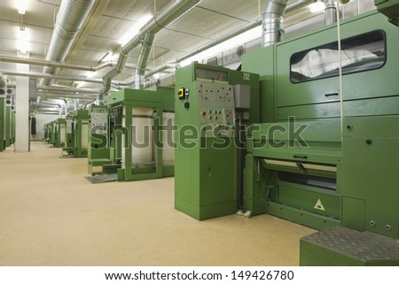 View of machinery in row at Spinning Factory - stock photo