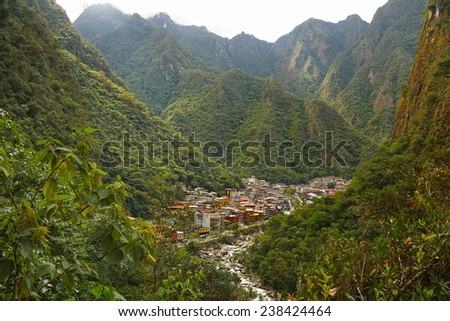 View of Machupicchu Pueblo from the surrounding mountains. Also known as Aguas Calientes serves as a terminal for the train service from Cusco. The road to visit the ruins of Machupicchu starts here.  - stock photo