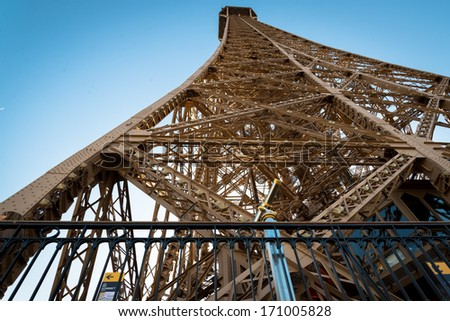 View of magnificent Eiffel Tower from first level.  In Paris, Fr - stock photo