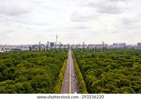 view of main street ( 17th of June Street / Strasse des 17. Juni )  and Berlin city: tv tower, Brandenburg gate, reichstag, Tiergarten and cathedral dome