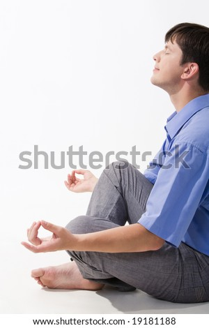 View of man doing yoga exercise and taking pleasure in it