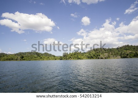 View of man-made lake of Royal Belum with nice green scenery and stumped wood.