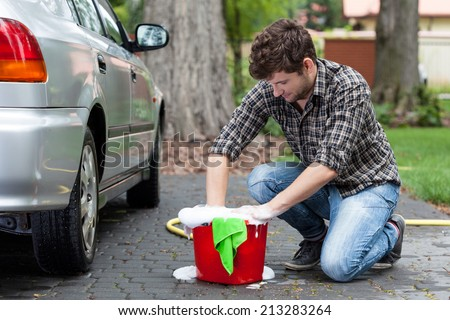 View of man ready for car cleaning - stock photo