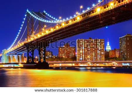 View of Manhattan Bridge in New York City at night - stock photo