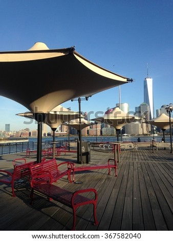 View of Manhattan, New York, NY from J. Owen Grundy Park in Exchange Place in Jersey City, NJ. - stock photo