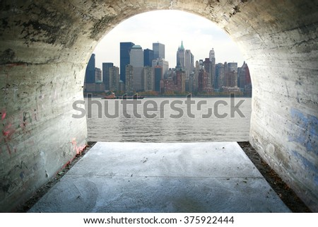 View of Manhattan through cement tunnel. - stock photo