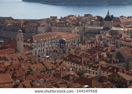 View of many landmarks of Old town in city of Dubrovnik, Croatia. Classic orange tiled rooftops are very famous in Dubrovnik.