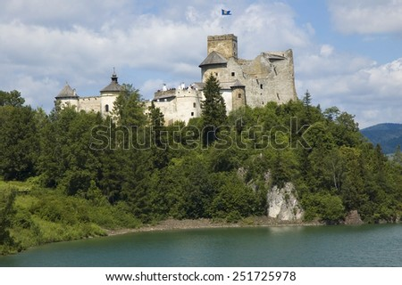 View of medieval castle in Niedzica against cloudy sky, Poland  - stock photo