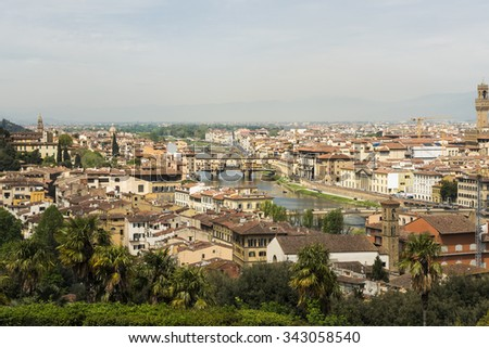 View of medieval stone bridge Ponte Vecchio and the Arno River in Florence, Tuscany, Italy. Florence is a popular tourist destination of Europe.