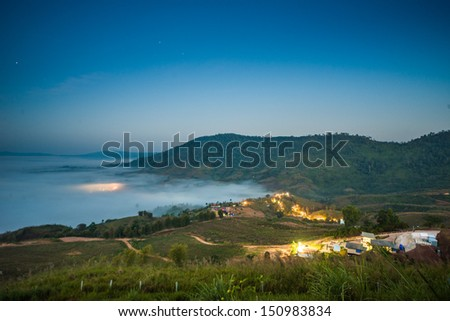 View of misty fog mountains in autumn - stock photo