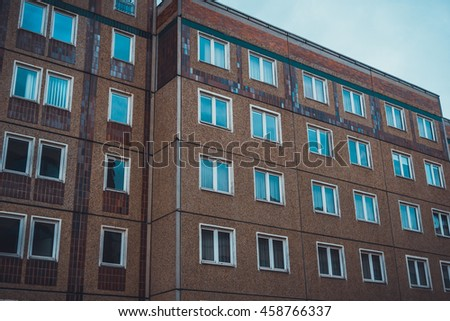 View of modern apartments or condominium with brick walls and sky reflecting in window