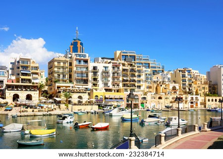 View of modern buildings and fishing boats in sea bay. Malta - stock photo