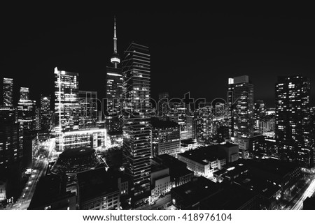 View of modern buildings at night in downtown Toronto, Ontario. - stock photo