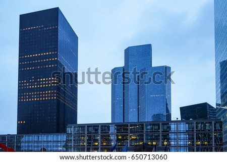 View of modern buildings in big city at evening