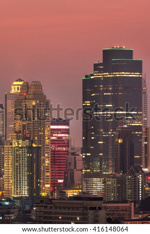 View of modern office buildings, condominium in big city downtown at twilight time - stock photo