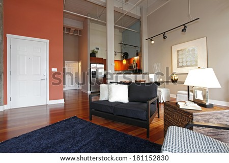 View of modern reconstructed living and kitchen room from a corner - stock photo