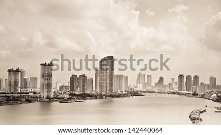 View of modern town  beside Chao Phraya River in Bangkok, Thailand..Processed with vintage syle. - stock photo