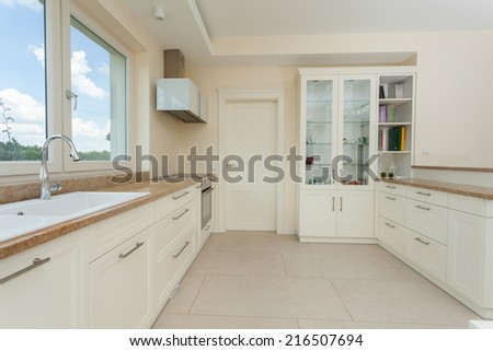 View of modern white kitchen with granite tops - stock photo