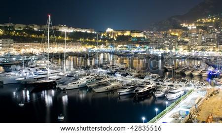 View of Monaco harbour, Monte Carlo in Monaco at night - stock photo