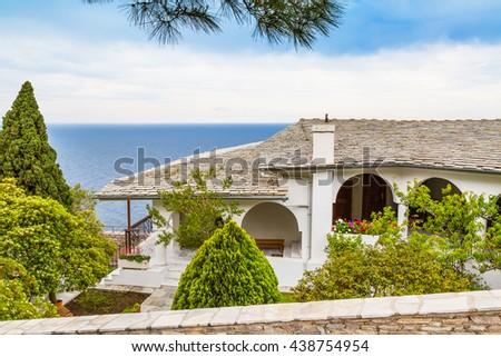View of Monastery of Archangel Michael, Thassos island, Greece and mount Athos far away - stock photo