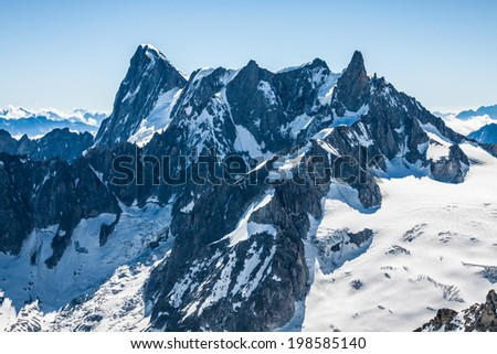 View of Mont Blanc mountain range from Aiguille Du Midi in Chamonix - landscape orientation - stock photo