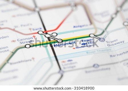 View of Monument station on a London subway map. (selective colouring) - stock photo